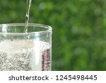 a cup of carbonated drink in a... | Shutterstock . vector #1245498445