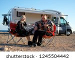 middle aged travelers couple... | Shutterstock . vector #1245504442