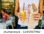 woman holding her breakfast and ... | Shutterstock . vector #1245507982
