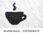 teacup with steam made of black ... | Shutterstock . vector #1245606415