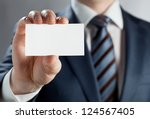man's hand showing business... | Shutterstock . vector #124567405