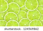 ?lose up green background with lime slices - stock photo