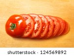chopped tomato on wooden cutting board - stock photo
