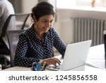 smiling indian female employee... | Shutterstock . vector #1245856558