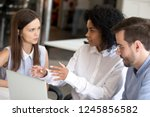 diverse employees discussing... | Shutterstock . vector #1245856582
