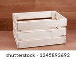 empty wooden box on brown floor ...   Shutterstock . vector #1245893692