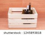 beer and wine bottles in wooden ...   Shutterstock . vector #1245893818