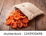 heap of dried apricots on... | Shutterstock . vector #1245920698