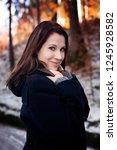 portrait of young brunette... | Shutterstock . vector #1245928582
