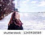 brunette young woman standing... | Shutterstock . vector #1245928585