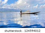 silhouette of a  traditional fishersboat on the Inle lake in Myanmar - stock photo