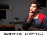 young handsome repairman... | Shutterstock . vector #1245946102