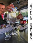 Small photo of Chagrin Falls, Ohio / United States - July 8, 2015: Bartender at Jekyll's Preparing Absinthe Alcoholic Drink for Two People