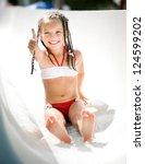 Little Girl On Water Slide At...