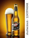 Small photo of ANKARA, TURKEY - January 2017: Miller beer bottle and frosty glass full of beer with foam. Miller Genuine Draft is a product of the Miller Brewing Company owned by SABMiller. Editorial use.