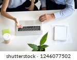 employees colleagues using... | Shutterstock . vector #1246077502