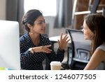 friendly female colleagues... | Shutterstock . vector #1246077505
