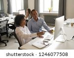 diverse colleagues discussing... | Shutterstock . vector #1246077508