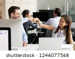 friendly smiling colleagues... | Shutterstock . vector #1246077568
