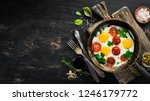 eggs with tomatoes and greens... | Shutterstock . vector #1246179772