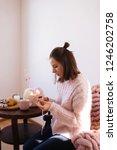 young brunette girl sitting in... | Shutterstock . vector #1246202758