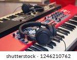 piano keyboard with headphones...   Shutterstock . vector #1246210762