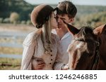 young beautiful couple with a... | Shutterstock . vector #1246246885