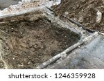 square pit with brown soil... | Shutterstock . vector #1246359928