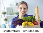 young woman holding grocery... | Shutterstock . vector #1246366582