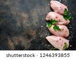 Raw Organic Chicken Breast On A ...