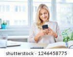 smiling woman using smartphone... | Shutterstock . vector #1246458775