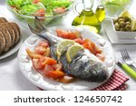 grilled gilt head bream with... | Shutterstock . vector #124650742