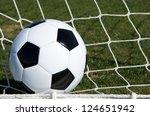 soccer ball in the goal scoring | Shutterstock . vector #124651942