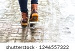 walk on wet melted ice pavement.... | Shutterstock . vector #1246557322