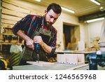 skilled craftsman in apron... | Shutterstock . vector #1246565968