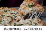 meal time at pizzeria  man... | Shutterstock . vector #1246578568