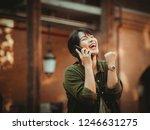 asian woman using smartphone... | Shutterstock . vector #1246631275