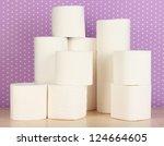 rolls of toilet paper on purple ...   Shutterstock . vector #124664605