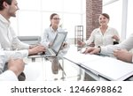 business partners sitting at... | Shutterstock . vector #1246698862