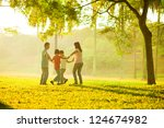 happy asian family playing on... | Shutterstock . vector #124674982