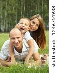 portrait of a family outdoors.... | Shutterstock . vector #1246754938