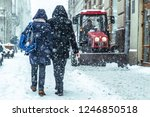 snowstorm in city. cleaning... | Shutterstock . vector #1246850518