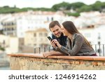 happy couple checking smart... | Shutterstock . vector #1246914262
