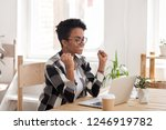 Stock photo excited african american woman in glasses read good news online at laptop happy black female get 1246919782