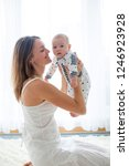 young mother  holding her... | Shutterstock . vector #1246923928