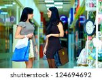 happy elegant women shopping in city mall - stock photo