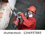 worker with demolition hammer... | Shutterstock . vector #1246957885