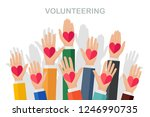 group of volunteer raise up... | Shutterstock .eps vector #1246990735