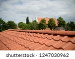 natural red roofing shingles in ... | Shutterstock . vector #1247030962