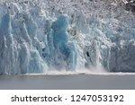 a edge of a glacier  calving... | Shutterstock . vector #1247053192